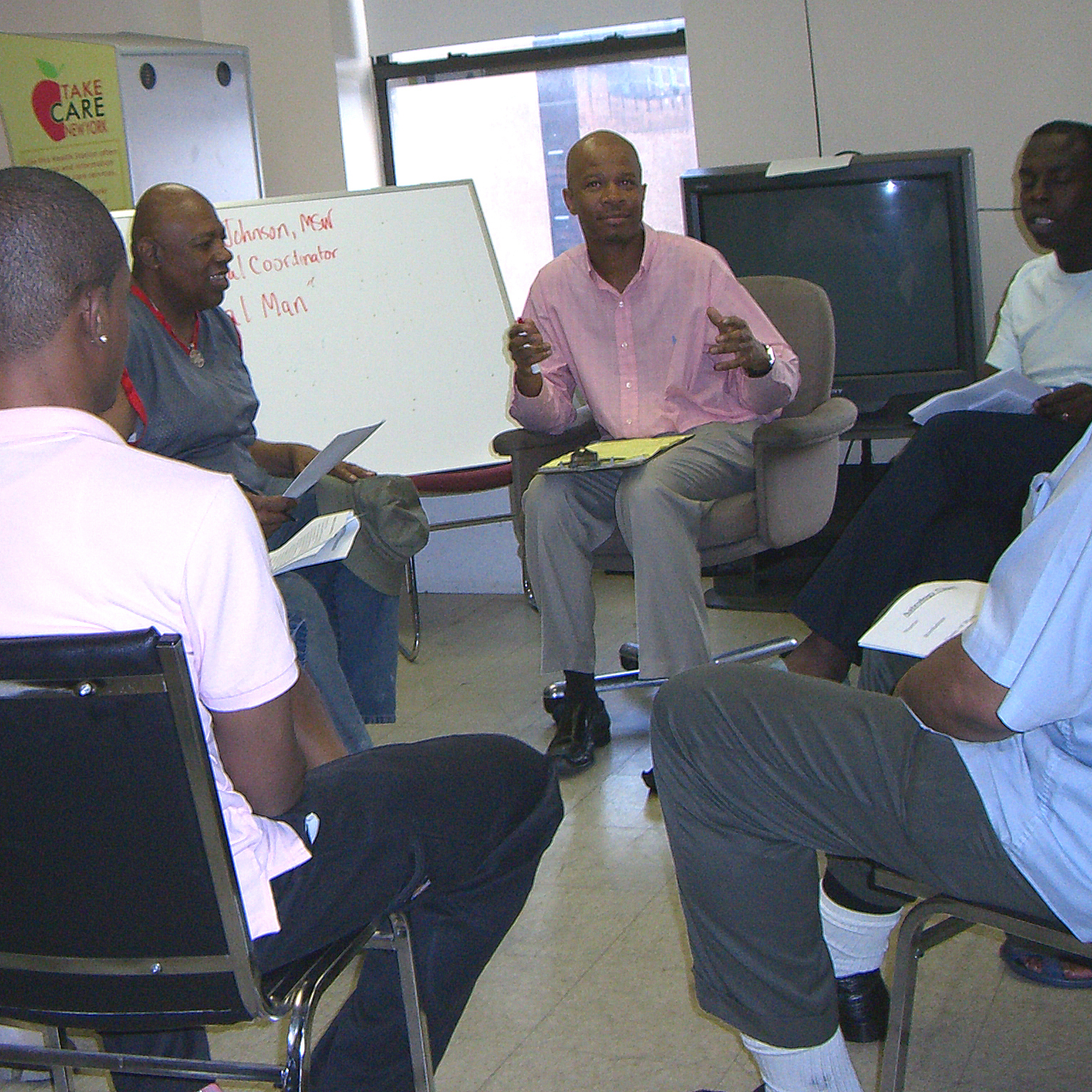 Men sitting in a circle and talking