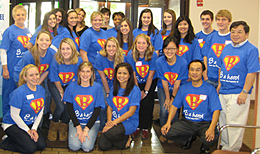 "Group of people wearing ""B a hero"" T shirts"