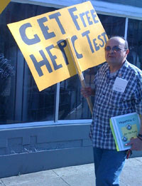 Man holding 'Get Free Hep C Test' sign.